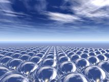 Field of Chrome Spheres. 3D rendering of a Perspective field of spheres reflecting the sky Stock Photo