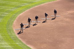 Field Clean-up. Minneapolis, MN - September 15, 2012: Five crew members clean the baseball diamond at a Minnesota Twins game at Target Field royalty free stock photos