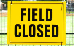 FIELD CLOSED sign attached to a fence Stock Image