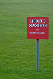 Field Closed sign in a grass field Stock Image