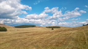 Field with clouds. Beautiful field with clouds in mountain Zlatibor,Serbia royalty free stock photo