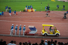 Field crew sets up hurdles for track and field eve. BEIJING, CHINA - AUGUST 16, 2008: Field crew sets up hurdles for track and field events in Birds Nest Stadium Stock Images