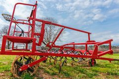 Field cultivator. Harrow system, cultivate the soil. stock photo