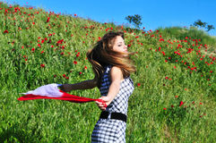 Field danser. Teen girl dancing in field and holding red scarf Stock Photography