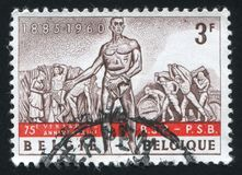 Field and dock workers. BELGIUM - CIRCA 1960: stamp printed by Belgium, shows The sower, field and dock workers, from Monument to Labor, circa 1960 Royalty Free Stock Photos