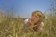 Field Dream. Young woman dreaming in the field Royalty Free Stock Photos