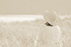 Field of dreams. Woman in meadow Royalty Free Stock Photo