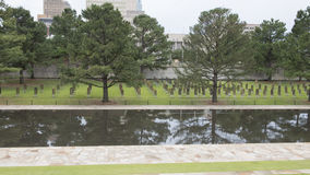 Field of Empty Chairs, granite walkway and reflective pool, Oklahoma City Memorial Stock Photo