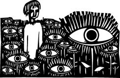 Field of Eyes. Woodcut style expressionist image of a boy standing in a field of watching eyes Stock Images