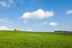 A field with a farm Stock Images