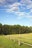Field fence and blue sky Royalty Free Stock Images