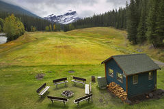 Field for a golf. A field for a golf, a brazier, benches and a small house for rest in park stock image