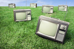 Field of grass with retro tv's Stock Photos
