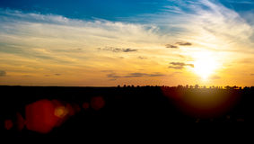Field of grass and sunset Royalty Free Stock Photography