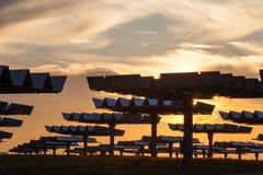 Field of Green Energy Photovoltaic Solar Panels Sunset or Sunris Stock Photos