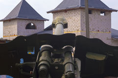 Field Gun Aiming at Castle. POV Modern Artillery Gun Aiming at Old Castle royalty free stock photography