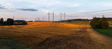 Field after harvest. In the countryside. Scenic rural landscape at sunset. Panorama shot Royalty Free Stock Photography