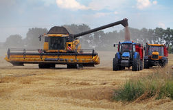 Field and harvester Stock Photo