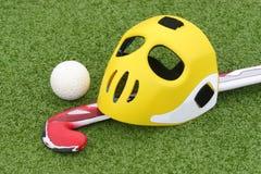 Field hockey. Equipment on green grass stock photography