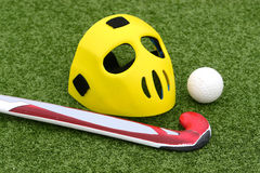 Field hockey. Equipment on green grass Stock Photo