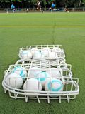 Field hockey balls. On playing-field royalty free stock photo