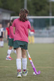 Field Hockey. A girl playing field hockey in Holland Royalty Free Stock Photo