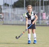 Field Hockey. A girl playing field hockey in Holland Stock Photography
