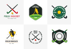 Field hockey logo set. Vector sport badges with man silhouette, stick and  ball. Field hockey logo set. Vector sport badges with man silhouette, stick and Stock Photos