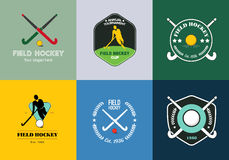 Field hockey logo set. Vector sport badges with man silhouette, stick and hockey ball.  Stock Photo