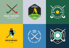Field hockey logo set. Vector sport badges with woman silhouette, stick and hockey ball. Stock Photography