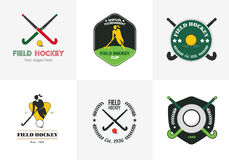 Field hockey logo set. Vector sport badges with woman silhouette, stick and hockey ball. Royalty Free Stock Photo