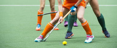 Field hockey midfield challenge Royalty Free Stock Photos