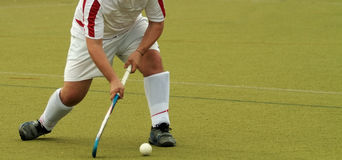 Field Hockey Player. A field hockey player about to hit the ball royalty free stock photos