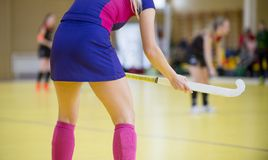 Field hockey player girl with stick in the game. Back view stock photo
