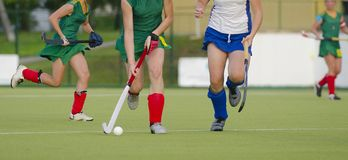 Field Hockey player, ready to pass the ball to a team mate royalty free stock images