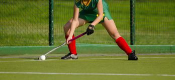 Field Hockey player, ready to pass the ball to a team mate royalty free stock image