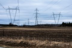 Field of Hydro Lines. High voltage Hydro lines running through country fields. These lines run all the way to northern Ontario Stock Photos