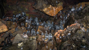 A field of ice stalagmites. A sea of ice stalagmites in a lava tube tunnel in Iceland stock photos