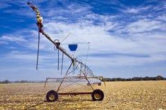 Field Irrigation. Linear irrigation machine rolls across a Kansas farm field stock images