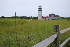 Field and Lighthouse Stock Photo