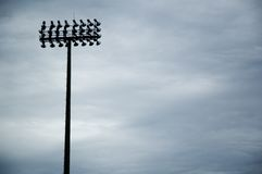 Field lights. Playing field lights against the sky with copy space on the right Royalty Free Stock Photos