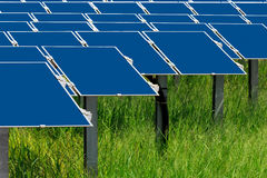 Field with many solar cells on green grass Stock Photography