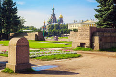 Field of Mars and Church of the Savior on Spilled Blood in St.Peteresburg. Field of Mars Marsovo pole in Saint Petersburg, tombstone inscriptions on the plates Royalty Free Stock Photos