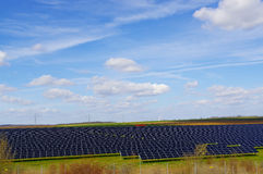 Field and medow with solar panels on it. A fiald with solar photovoltaic panels photovoltaic Stock Photography
