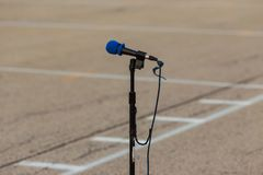 field microphone for soloists performing at a marching band rehearsal stock images
