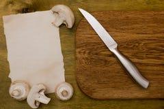 Field mushrooms on a cutting board Stock Photo
