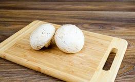 Field mushrooms on a cutting board Stock Photos