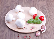 Field mushrooms, garlic, basil and tomatoes Royalty Free Stock Photos