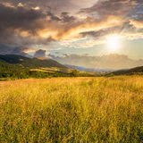Field near home in mountains at sunset Royalty Free Stock Image