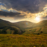 Field near home in mountains at sunset Stock Photo